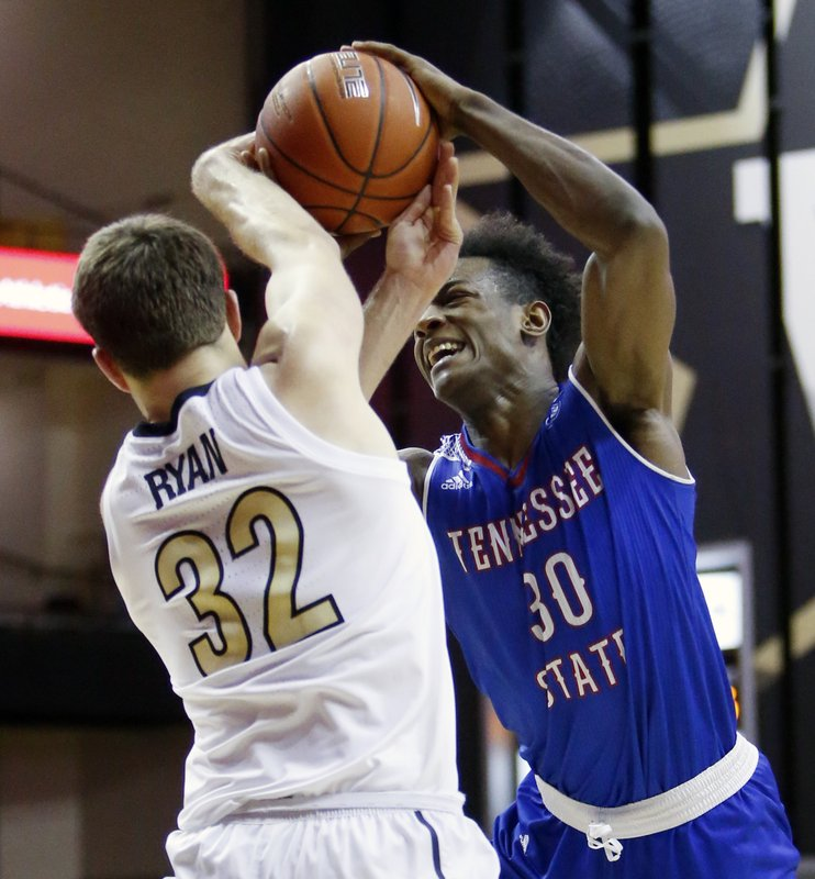 Tennessee State forward Stokley Chaffee Jr. (30) drives against Vanderbilt forward Matt Ryan (32) in the first half of an NCAA college basketball game Saturday, Dec. (AP Photo/Mark Humphrey)