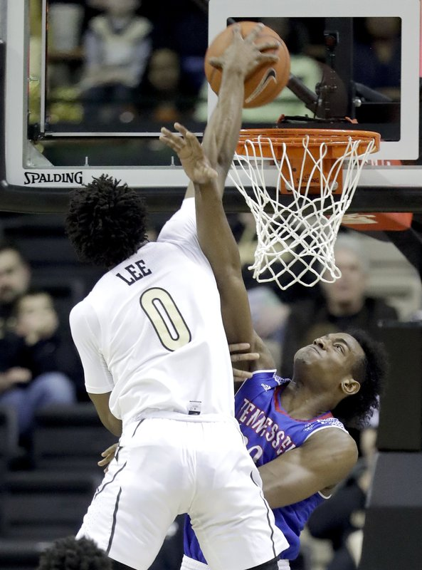 Vanderbilt guard Saben Lee (0) dunks over Tennessee State forward Stokley Chaffee Jr. in the first half of an NCAA college basketball game Saturday, Dec. (AP Photo/Mark Humphrey)