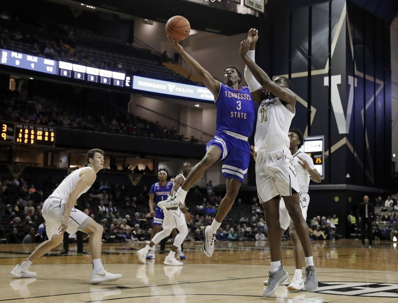 Tennessee State guard Donte Fitzpatrick-Dorsey (3) drives against Vanderbilt forward Simisola Shittu in the first half of an NCAA college basketball game Saturday, Dec. (AP Photo/Mark Humphrey)