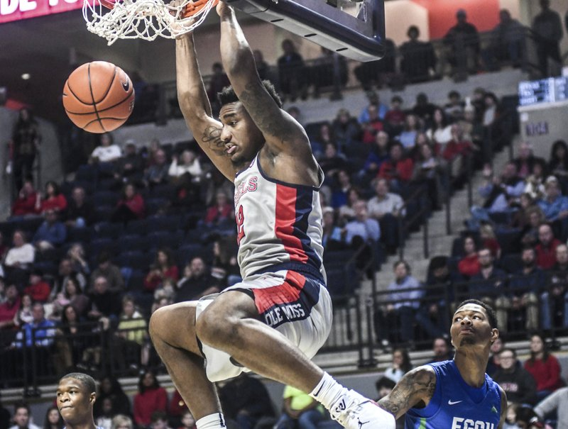 Mississippi's Bruce Stevens (12) dunks against Florida Gulf Coast's Troy Baxter Jr. (1)   during an NCAA college basketball game Saturday, Dec. (Bruce Newman/Oxford Eagle via AP)