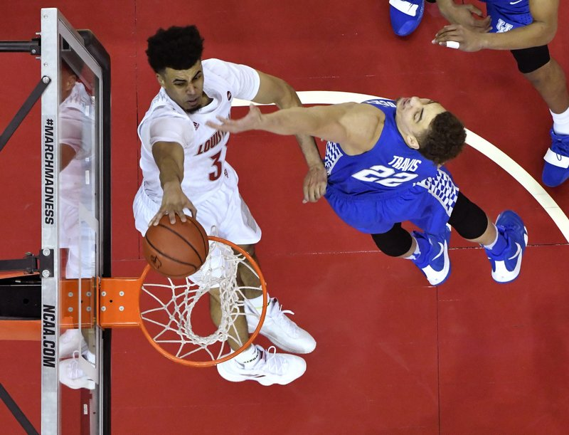 Kentucky forward Reid Travis (22) attempts to stop Louisville forward Jordan Nwora (33) from scoring during the second half of an NCAA college basketball game in Louisville, Ky. (AP Photo/Timothy D. Easley)