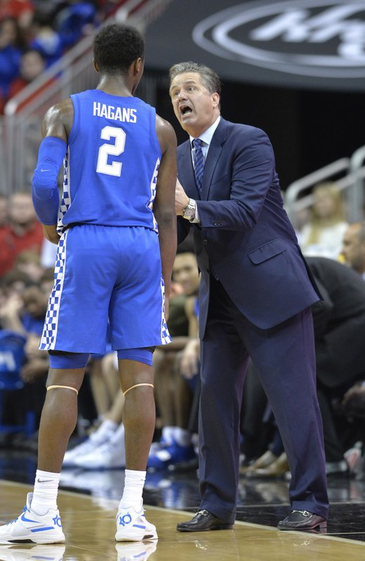 Kentucky head coach John Calipari gives instructions to guard Ashton Hagans (2) during the second half of an NCAA college basketball game against Louisville in Louisville, Ky. (AP Photo/Timothy D. Easley)