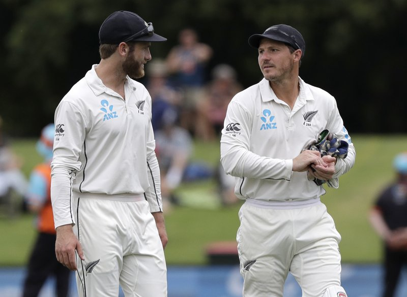 New Zealand captain Kane Williamson, left, walks from the field with teammate BJ Watling following their 423 run win over Sri Lanka on the final day of the second cricket test at Hagley Oval in Christchurch, New Zealand, Sunday, Dec. (AP Photo/Mark Baker)
