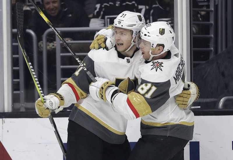 Vegas Golden Knights' William Karlsson, left, celebrates his goal with teammate Jonathan Marchessault during the third period of an NHL hockey game against the Los Angeles Kings on Saturday, Dec. (AP Photo/Marcio Jose Sanchez)