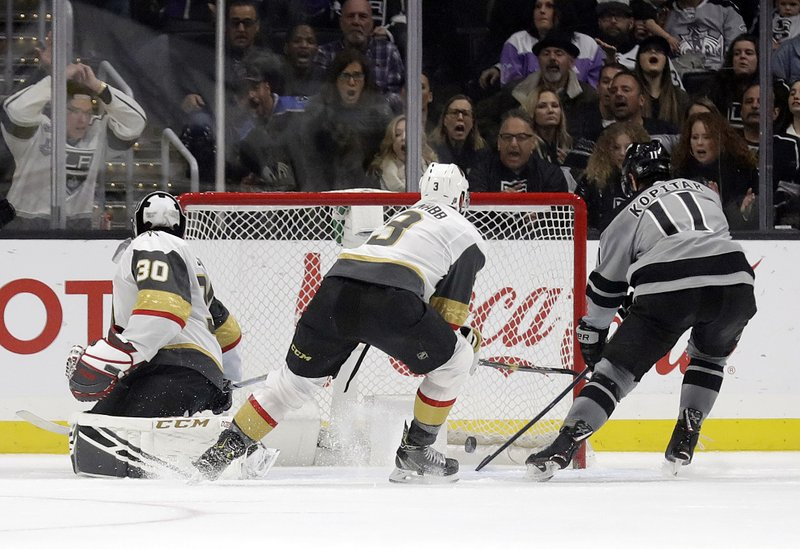 Los Angeles Kings center Anze Kopitar, right, scores past Vegas Golden Knights' Brayden McNabb, center, and goaltender Malcolm Subban (30) during the first period of an NHL hockey game Saturday, Dec. (AP Photo/Marcio Jose Sanchez)