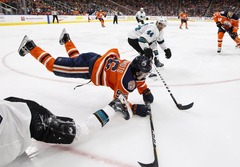San Jose Sharks' Marc-Edouard Vlasic (44) takes the puck as Edmonton Oilers' Kailer Yamamoto (56) is tripped up during the second period of an NHL hockey game, Saturday, Dec. (Jason Franson/The Canadian Press via AP)