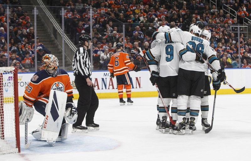 San Jose Sharks players Including Evander Kane (9) and Brent Burns (88) celebrate a goal as Edmonton Oilers' goalie Cam Talbot (33) looks on during the first period of an NHL hockey game, Saturday, Dec. (Jason Franson/The Canadian Press via AP)