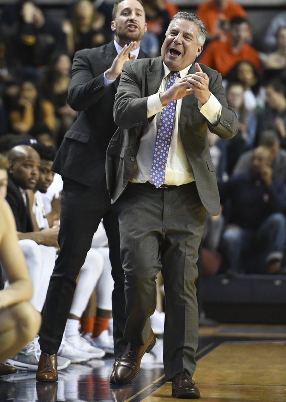 Auburn coach Bruce Pearl cheers after a score against North Florida during the first half of an NCAA college basketball game Saturday, Dec. (AP Photo/Julie Bennett)