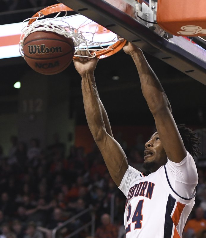Auburn forward Anfernee McLemore (24) dunks against North Florida during the first half of an NCAA college basketball game Saturday, Dec. (AP Photo/Julie Bennett)