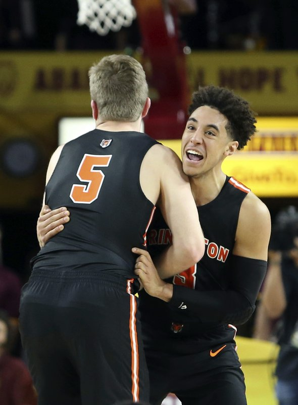Princeton guard Devin Cannady, right, and teammate Drew Friberg (5) celebrate following a victory over Arizona State in an NCAA college basketball game, Saturday, Dec. (AP Photo/Ralph Freso)