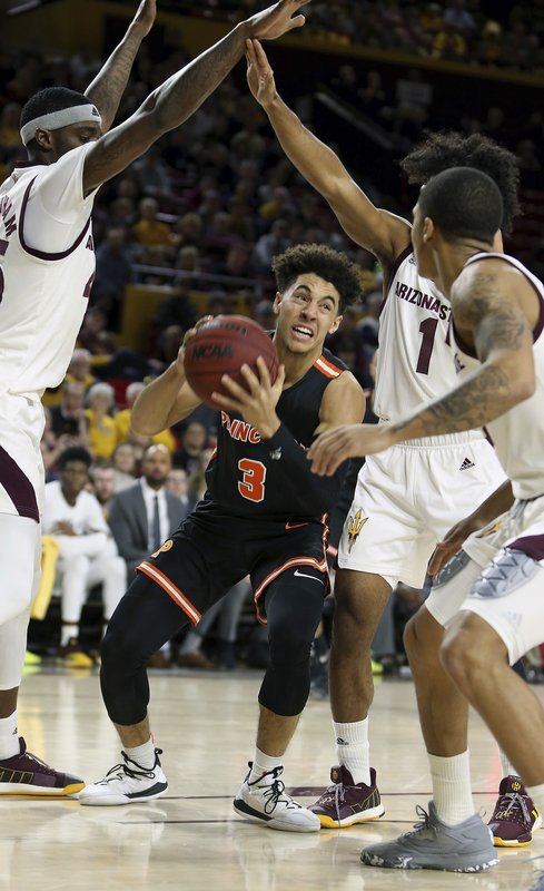 Princeton guard Devin Cannady (3) drives to the basket as Arizona State's Zylan Cheatham, left, Remy Martin (1) and Rob Edwards defend during the first half of an NCAA college basketball game Saturday, Dec. (AP Photo/Ralph Freso)