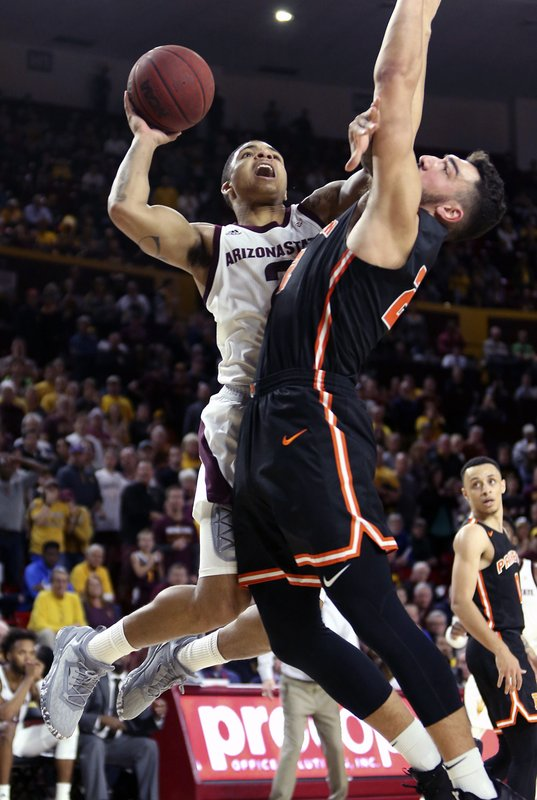 Arizona State guard Rob Edwards, left, drives to the basket as Princeton's Jerome Desrosiers defends during the second half of an NCAA college basketball game, Saturday, Dec. (AP Photo/Ralph Freso)