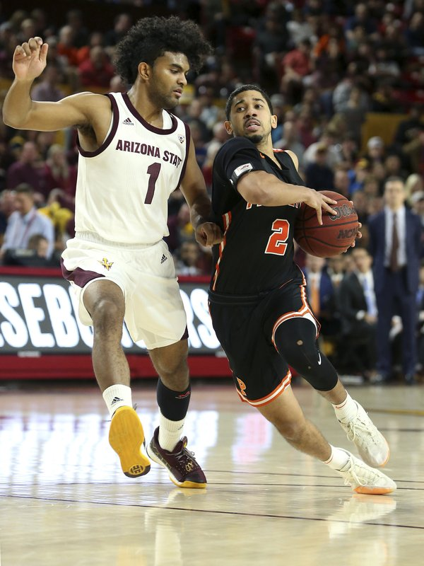 Princeton guard Jose Morales (2) drives to the basket as Arizona State's Remy Martin defends during the first half of an NCAA college basketball game Saturday, Dec. (AP Photo/Ralph Freso)