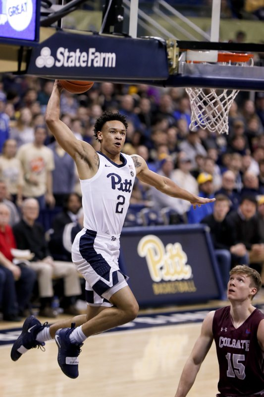 Pittsburgh's Trey McGowens (2) goes past Colgate's Tucker Richardson (15) to dunk during the first half of an NCAA college basketball game, Saturday, Dec. (AP Photo/Keith Srakocic)