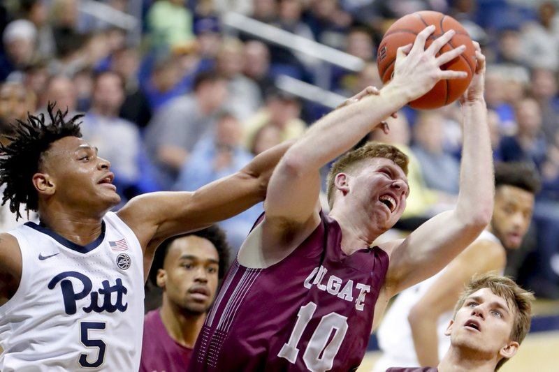 Colgate's Will Rayman (10) gets a rebound in front of Pittsburgh's Au'Diese Toney (5) during the first half of an NCAA college basketball game, Saturday, Dec. (AP Photo/Keith Srakocic)