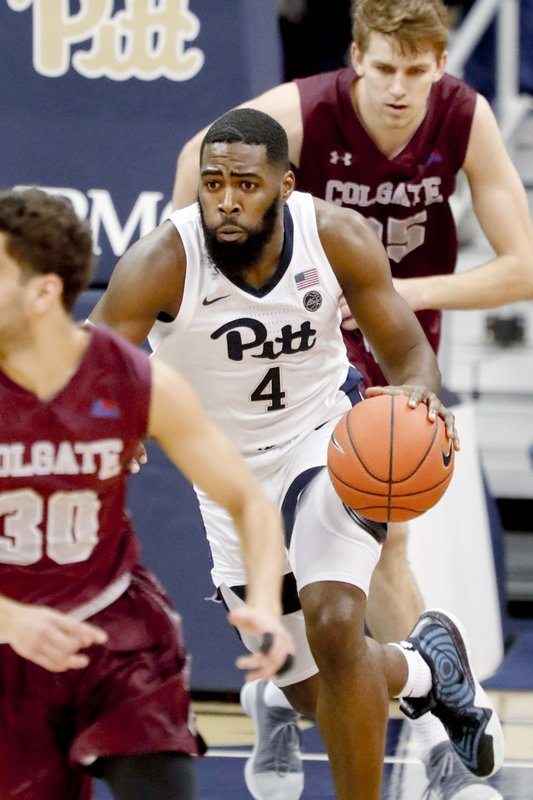 Pittsburgh's Jared Wilson-Frame (4) bring the ball down court between Colgate's Rapolas Ivanauskas, top, and Francisco Amiel (30) during the first half of an NCAA college basketball game, Saturday, Dec. (AP Photo/Keith Srakocic)