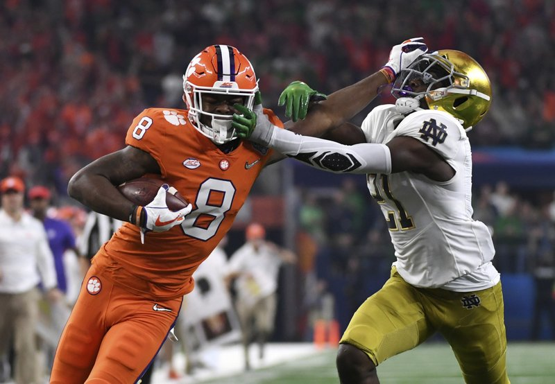 Clemson wide receiver Justyn Ross (8) fights off a tackle attempt by Notre Dame safety Jalen Elliott (21) and gets into the end zone for a touchdown in the first half of the NCAA Cotton Bowl semi-final playoff football game, Saturday, Dec. (AP Photo/Jeffrey McWhorter)
