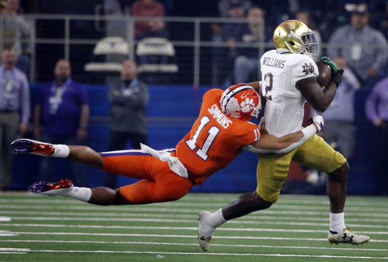 Clemson safety Isaiah Simmons (11) attempts to stop Notre Dame running back Dexter Williams (2) from gaining more yardage in the first half of the NCAA Cotton Bowl semi-final playoff football game, Saturday, Dec. (AP Photo/Michael Ainsworth)