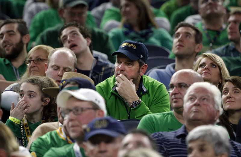 Notre Dame fans watch play against Clemson late in the second half of the NCAA Cotton Bowl semi-final playoff football game, Saturday, Dec. (AP Photo/Michael Ainsworth)