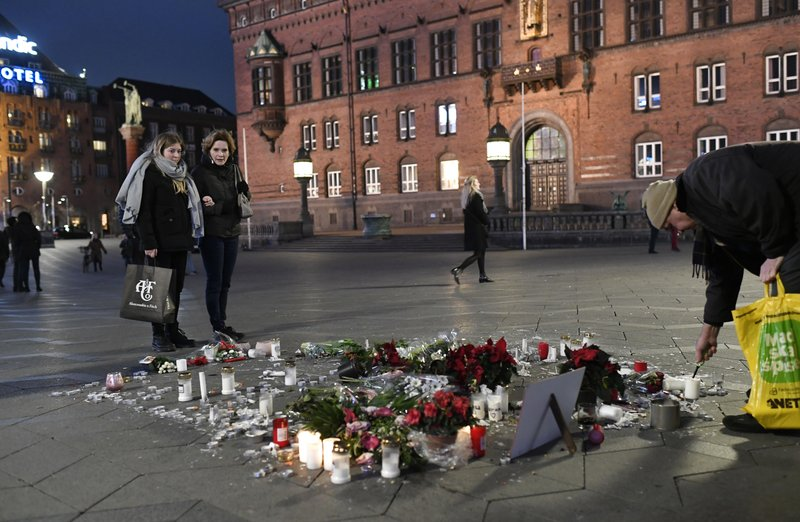 Tributes are placed in memory of two Scandinavian university students who were killed in a remote area of the Atlas Mountains in Morocco, at the Town Hall Square in Copenhagen, Friday Dec. (Thomas Sjoerup / Ritzau Scanpix)