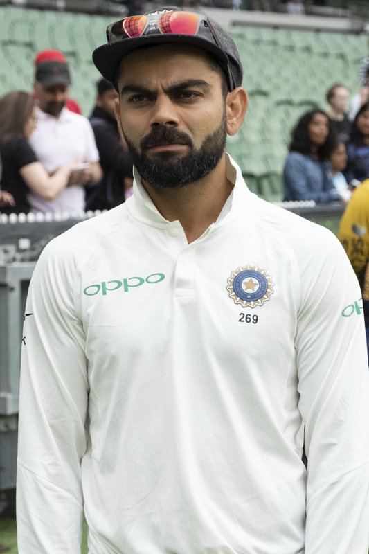 India's Virat Kohli on the sideline awaits the commencement of play during day five of the third cricket test between India and Australia in Melbourne, Australia, Sunday, Dec. (AP Photo/Asanka Brendon Ratnayake)