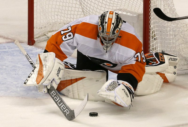Philadelphia Flyers goaltender Carter Hart (79) makes a second period save against the Florida Panthers in an NHL hockey game, Saturday Dec. (AP Photo/Joe Skipper)