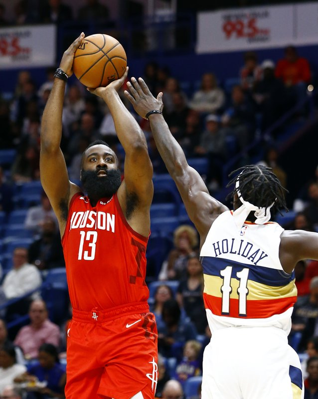 Houston Rockets guard James Harden (13)  shoots over New Orleans Pelicans guard Jrue Holiday (11) during the first half of an NBA basketball game, Saturday, Dec. (AP Photo/Butch Dill)