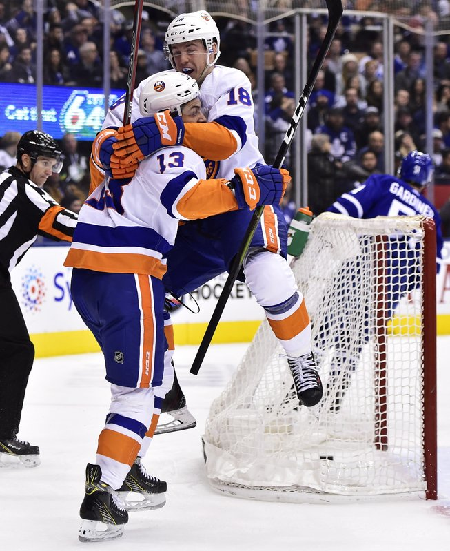 New York Islanders center Mathew Barzal (13) celebrates his goal against the Toronto Maple Leafs with teammate Anthony Beauvillier during the second period of an NHL hockey game Saturday, Dec. (Frank Gunn/The Canadian Press via AP)