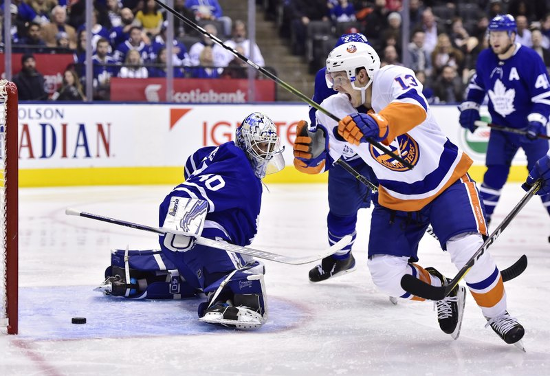 New York Islanders center Mathew Barzal (13) scores on Toronto Maple Leafs goaltender Garret Sparks (40) during the second period of an NHL hockey game Saturday, Dec. (Frank Gunn/The Canadian Press via AP)