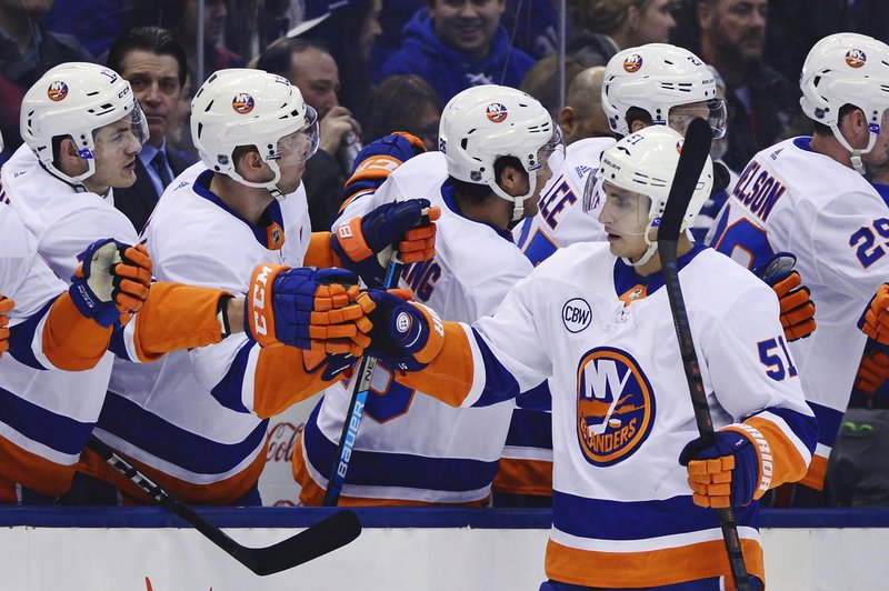 New York Islanders centre Valtteri Filppula (51) celebrates his goal against the Toronto Maple Leafs during first period NHL hockey action in Toronto on Saturday, December 29, 2018. THE CANADIAN PRESS/Frank Gunn/The Canadian Press via AP)