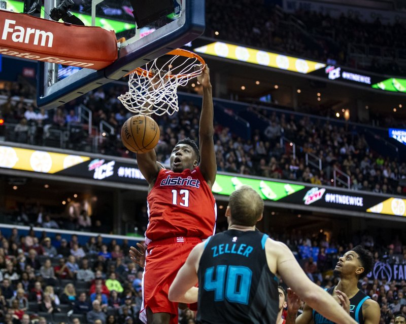 Washington Wizards center Thomas Bryant (13) dunks in front of Charlotte Hornets center Cody Zeller (40 during the second half of an NBA basketball game Saturday, Dec. (AP Photo/Al Drago)