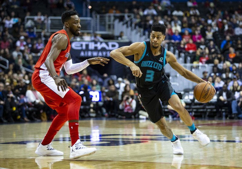 Charlotte Hornets guard Jeremy Lamb (3) drives against Washington Wizards forward Jeff Green during the first half of an NBA basketball game Saturday, Dec. (AP Photo/Al Drago)