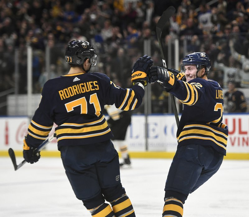Buffalo Sabres center Johan Larsson, right, celebrates his short-handed goal with left wing Evan Rodrigues during the second period of an NHL hockey game against the Boston Bruins in Buffalo, N. (AP Photo/Adrian Kraus)