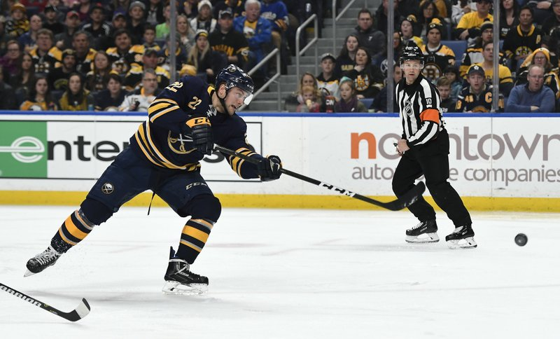 Buffalo Sabres center Johan Larsson (22) scores a short-handed goal past Boston Bruins goalie Tuukka Rask (40) during the second period of an NHL hockey game in Buffalo, N. (AP Photo/Adrian Kraus)