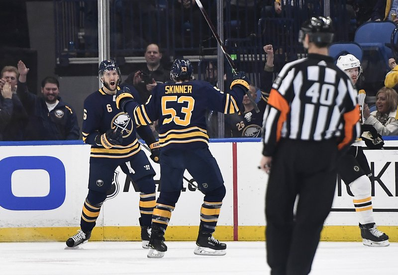 Buffalo Sabres defenseman Marco Scandella, left, celebrates his goal with left wing Jeff Skinner (53) during the first period of an NHL hockey game against the Boston Bruins in Buffalo, N. (AP Photo/Adrian Kraus)