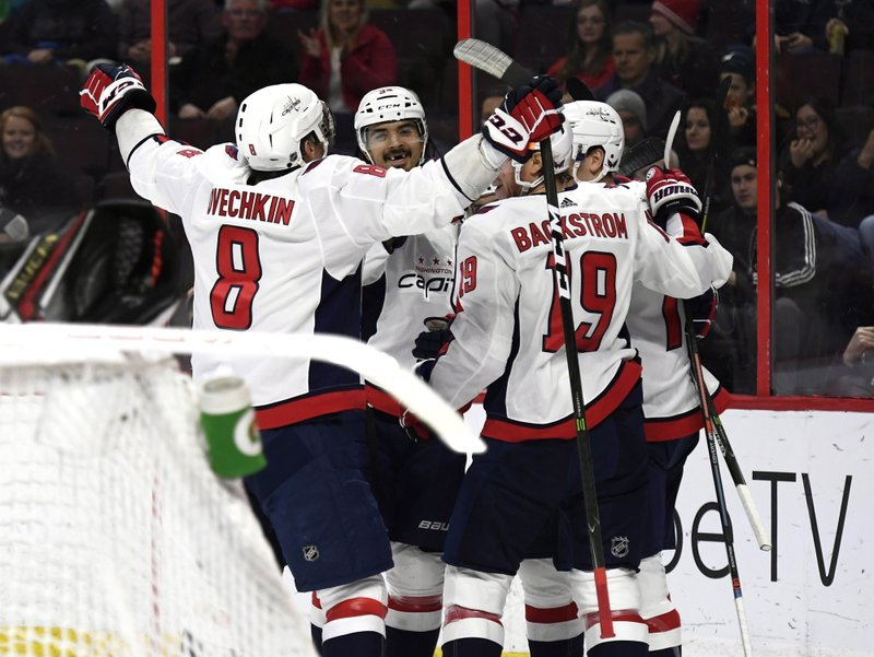 Washington Capitals players celebrate a goal against the Ottawa Senators during the first period of an NHL hockey game, Saturday, Dec. (Justin Tang/The Canadian Press via AP)