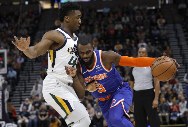 New York Knicks' Tim Hardaway Jr. (3) drives to the basket as he is defended by Utah Jazz's Donovan Mitchell, left, in the first half of an NBA basketball game on Saturday, Dec. (AP Photo/Kim Raff)