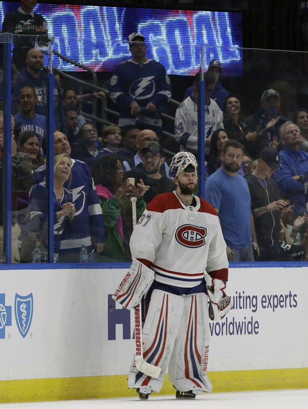 Montreal Canadiens goaltender Antti Niemi (37) watches the replay of Tampa Bay Lightning left wing Adam Ernes' goal during the third period of an NHL hockey game Saturday, Dec. (AP Photo/Chris O'Meara)