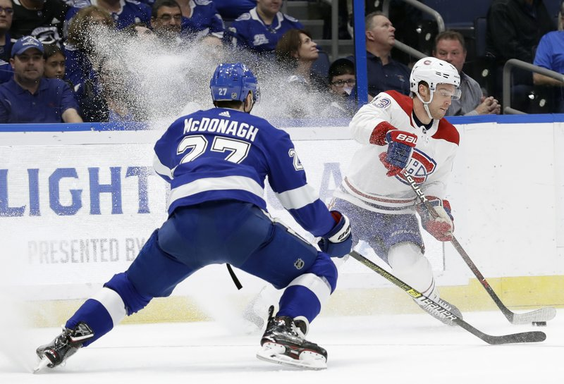Montreal Canadiens center Max Domi (13) stops short in front of Tampa Bay Lightning defenseman Ryan McDonagh (27) during the first period of an NHL hockey game Saturday, Dec. (AP Photo/Chris O'Meara)