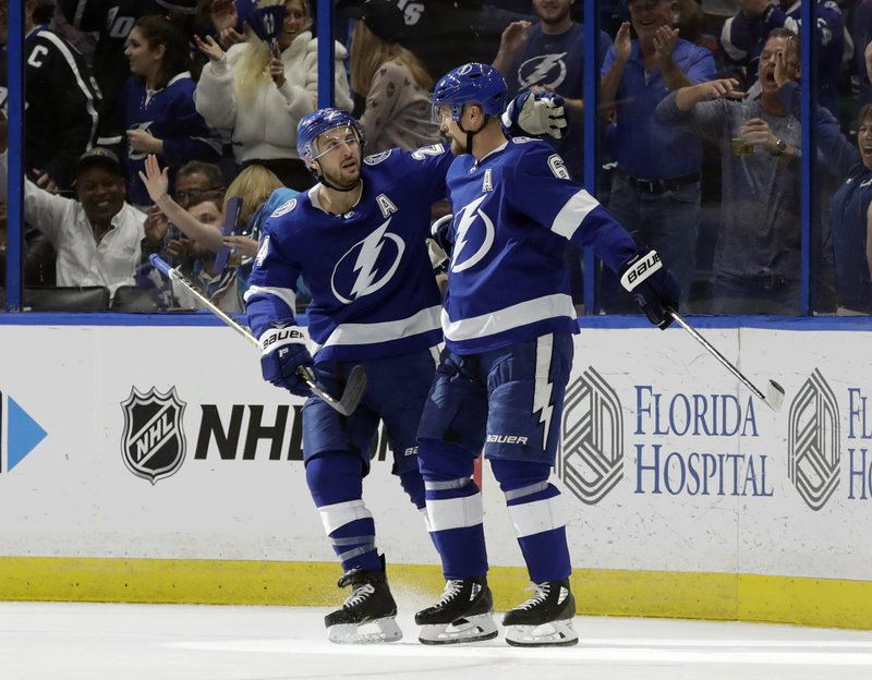 Tampa Bay Lightning defenseman Anton Stralman (6) celebrates his goal against the Montreal Canadiens with right wing Ryan Callahan (24) during the first period of an NHL hockey game Saturday, Dec. (AP Photo/Chris O'Meara)