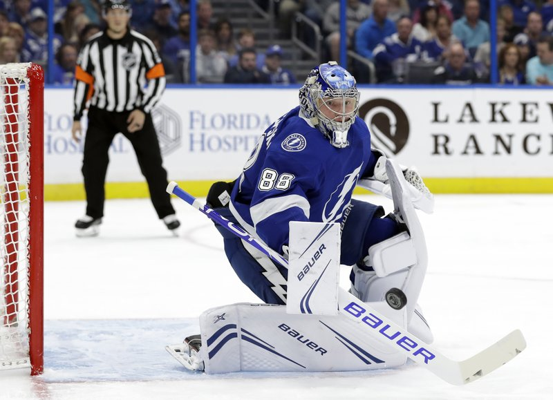 Tampa Bay Lightning goaltender Andrei Vasilevskiy (88) makes a save on a shot by the Montreal Canadiens during the first period of an NHL hockey game Saturday, Dec. (AP Photo/Chris O'Meara)