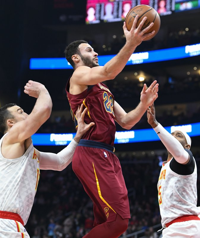 Cleveland Cavaliers forward Larry Nance Jr., center, shoots as Atlanta Hawks center Miles Plumlee, left, and forward Vince Carter, right, defend during the first half of an NBA basketball game, Saturday, Dec. (AP Photo/John Amis)