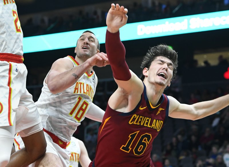 Cleveland Cavaliers forward Cedi Osman (16) reacts after being fouled while shooting against the Atlanta Hawks during the first half of an NBA basketball game, Saturday, Dec. (AP Photo/John Amis)