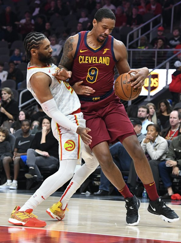 Cleveland Cavaliers forward Channing Frye (9) is defended by Atlanta Hawks forward DeAndre' Bembry during the first half of an NBA basketball game, Saturday, Dec. (AP Photo/John Amis)