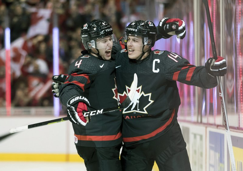 Canada's Jared McIsaac, left, and Maxime Comtois celebrate Comtois' goal against the Czech Republic during first-period IIHF world junior hockey championship game action in Vancouver, British Columbia, Saturday, Dec. (Darryl Dyck/The Canadian Press via AP)