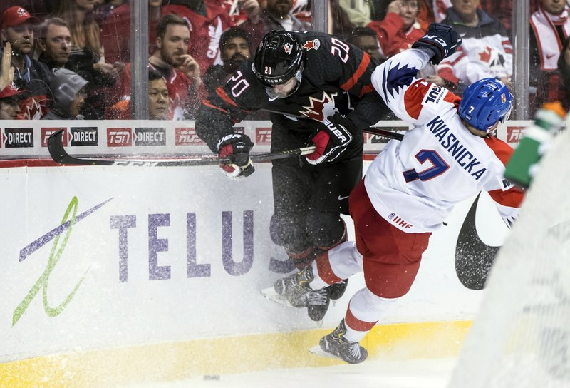 Canada's Brett Leason, left, and Czech Republic's David Kvasnicka collide during third-period IIHF world junior hockey championship game action in Vancouver, British Columbia, Saturday, Dec. (Darryl Dyck/The Canadian Press via AP)
