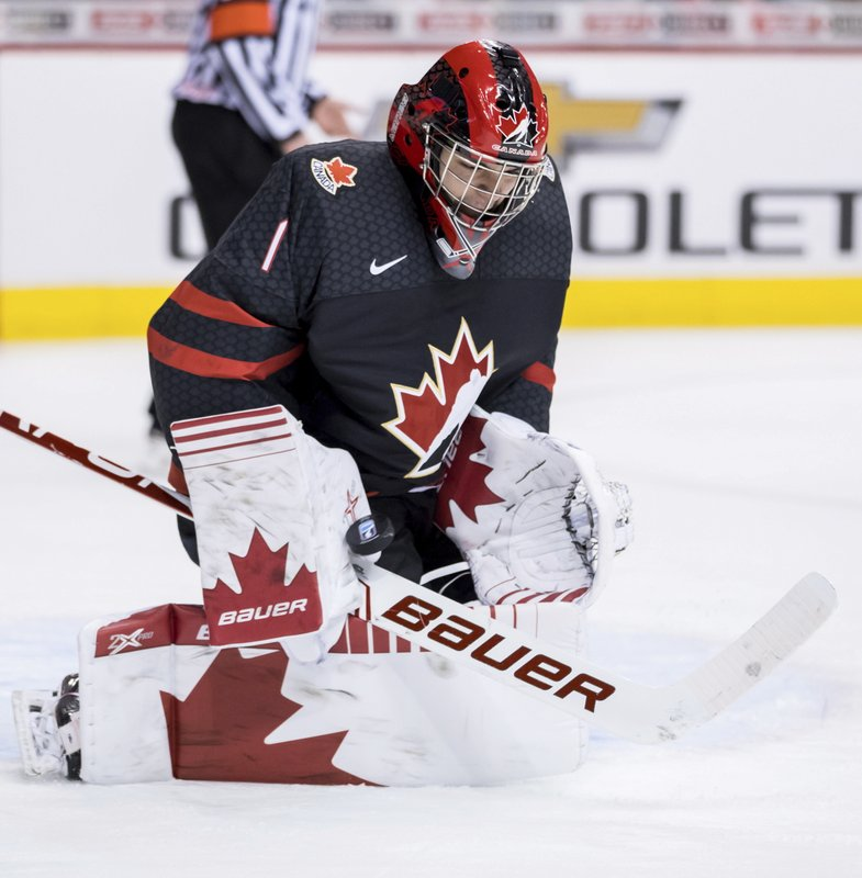 Canada goalie Michael DiPietro makes a save against the Czech Republic during second-period IIHF world junior hockey championship game action in Vancouver, British Columbia, Saturday, Dec. (Darryl Dyck/The Canadian Press via AP)