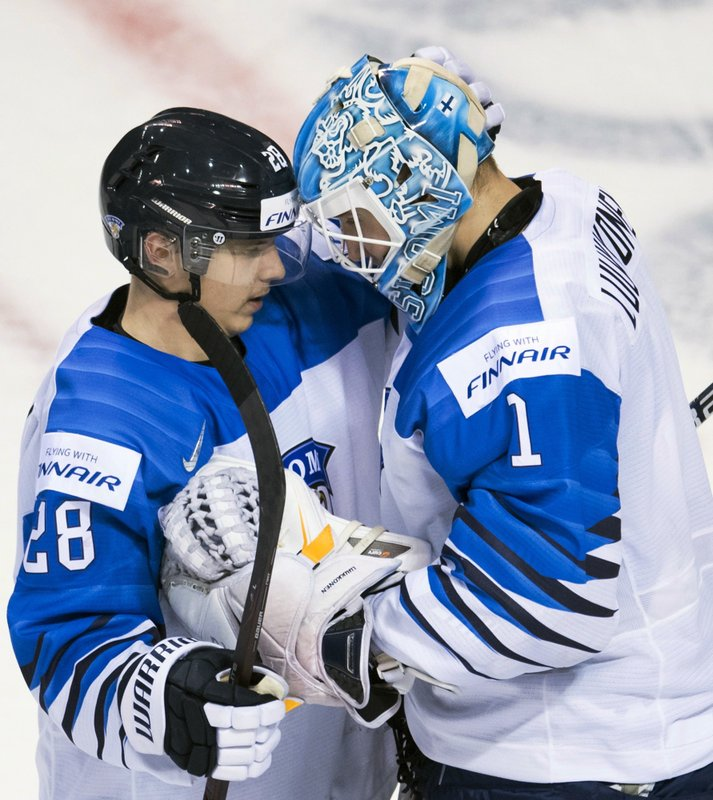 Finland's Ukko-Pekka Luukkonen goaltender celebrates his team's win over Slovakia with Sami Moilanen (28) following the third period of a world junior hockey championships game in Victoria, British Columbia, Saturday, Dec. (Jonathan Hayward/The Canadian Press via AP)