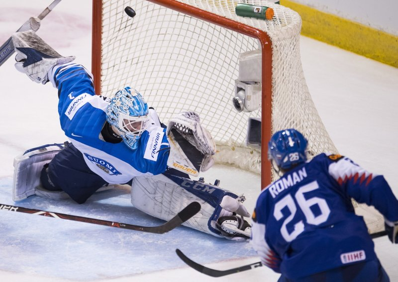 Slovakia's Milos Roman (26) sends a shot past Finland goaltender Ukko-Pekka Luukkonen (1) during the second period of a world junior hockey championships game in Victoria, British Columbia, Saturday, Dec. (Jonathan Hayward/The Canadian Press via AP)