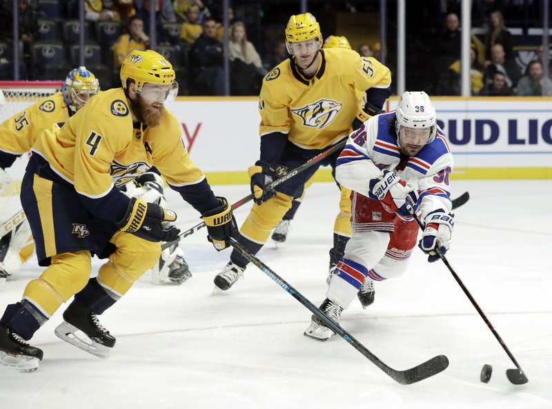 New York Rangers right wing Mats Zuccarello (36), of Norway, reaches for the puck with Nashville Predators defenseman Ryan Ellis (4) in the first period of an NHL hockey game Saturday, Dec. (AP Photo/Mark Humphrey)